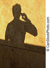 Man Shadow on Phone