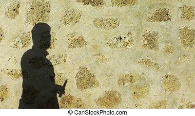 Man shadow smoking electronic cigarette