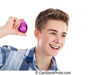 man shakes egg