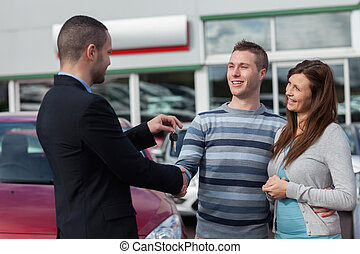 Man shaking hand with salesman