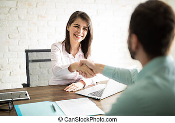 Man shaking hands with a woman