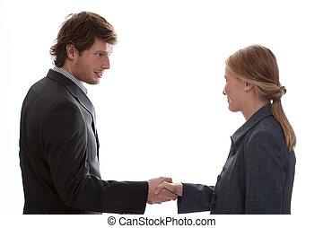 Man shaking woman hand