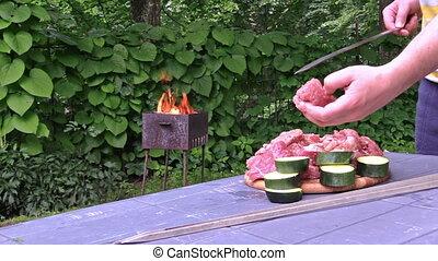 man shashlik grill skewer - man hand preparing shashlik and...