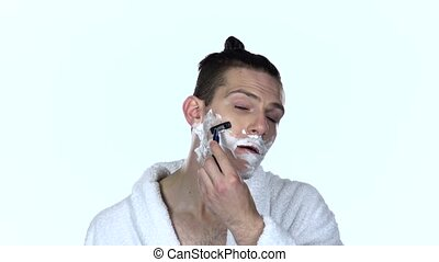 Man shaves stubble with razor blade. White background. Slow...