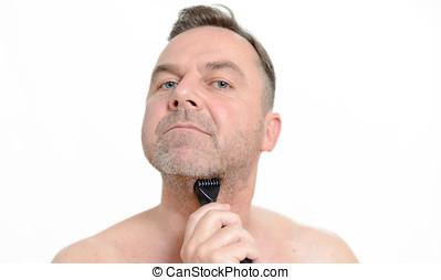 Man shaving his beard with a razor