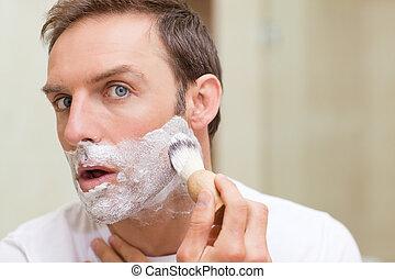 Man shaving in the bathroom