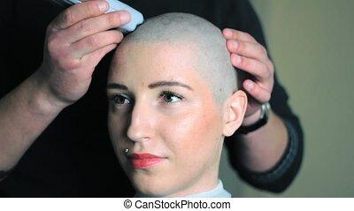 Man shaving pretty girl - Anonymous male hairdresser shaving...