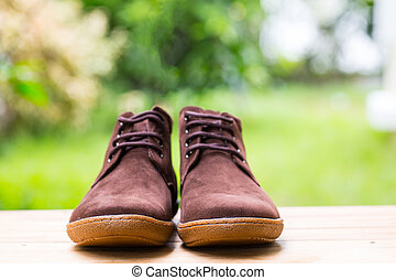Man shoes fashion on wood table