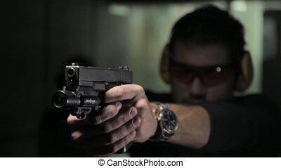 Man shooting a gun