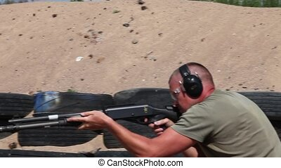 Man shooting rifle