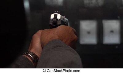 Man shooting targets in a range