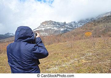 Man shooting view on beautiful mountains