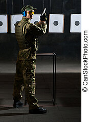Man shooting with gun