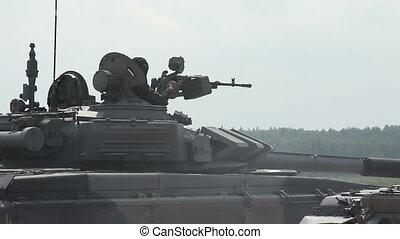 man shoots from tank-mounted machine guns - the firing of...