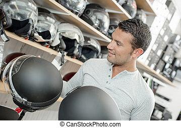 Man shopping for a motorbike helmet