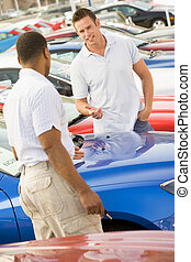Man shopping for a new car