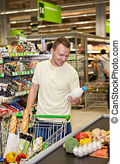 man shopping in a supermarket