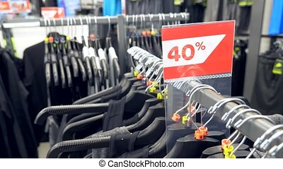 man shopping in clothes store, choose clothes. 4k, slow...