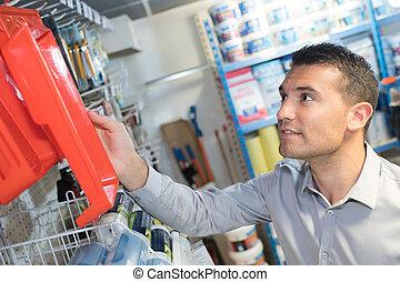 man shopping in hardware store