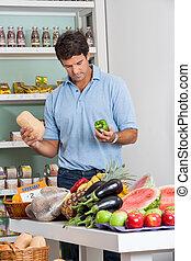 Man Shopping Vegetables In Supermarket