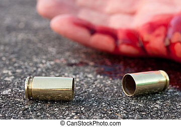 Man shot in street - A man shot in the streets with the...