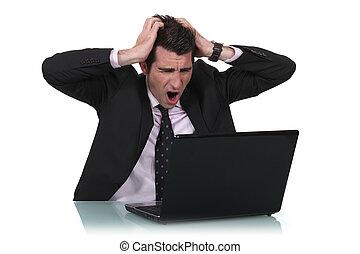 Man shouting at laptop