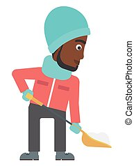 Man shoveling and removing snow. - An african-american man...