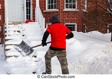 Man shoveling snow from front stairs