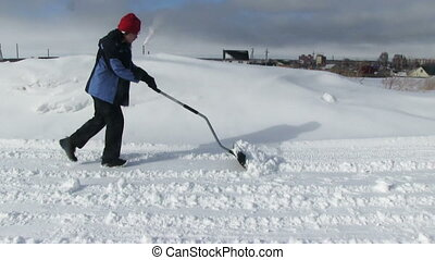 Man shoveling snow from the road