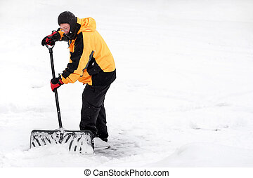 Winter scene with a man shoveling snow
