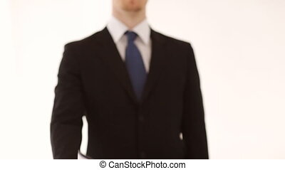 man showing a contract - man in suit and tie showing a...