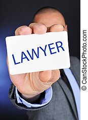 man showing a signboard with the word lawyer