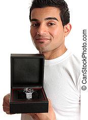 Man showing a wristwatch