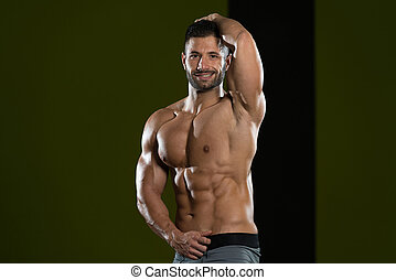 Man Showing Abdominal Muscle - Handsome Man Standing Strong ...