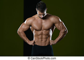 Man Showing Abdominal Muscle - Healthy Man Standing Strong ...