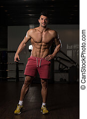 Man Showing Abdominal Muscle - Healthy Young Man Standing ...