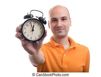 man showing an alarm clock