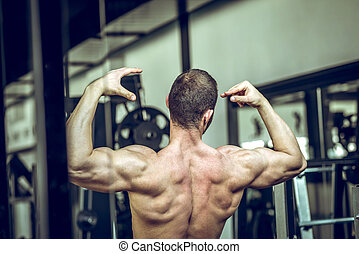 Man showing back in gym