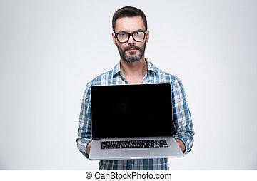 Man showing blank laptop computer screen