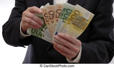 Man showing bundles of money and hands them in the direction of the camera - 4k