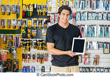 Man Showing Digital Tablet In Hardware Store