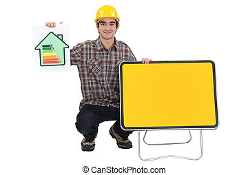 Man showing energy rating sign and yellow sign