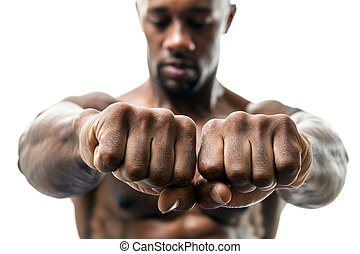 Man Showing Fists and Knuckles - Muscular man of African...