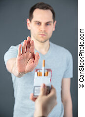 man showing hand stop smoking
