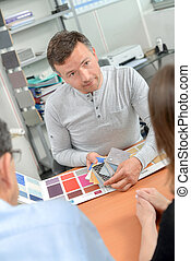 Man showing paint samples