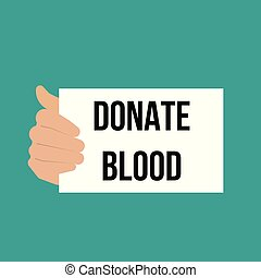 Man showing paper DONATE BLOOD text