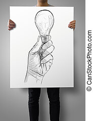 man showing poster of Hand drawn light bulb  as concept