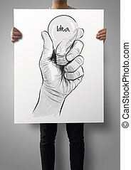 man showing poster of Hand drawn light bulb with IDEA word  as concept