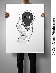 man showing poster of Hand drawn light bulb with THINK word on crumpled paper as concept