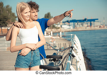 Man showing something to girlfriend outdoors